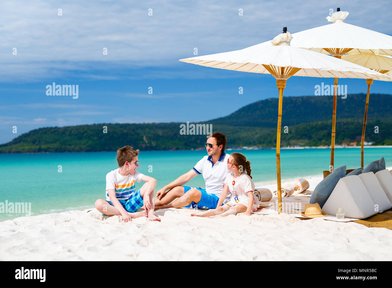 Family father and kids enjoying tropical beach vacation - Stock Image