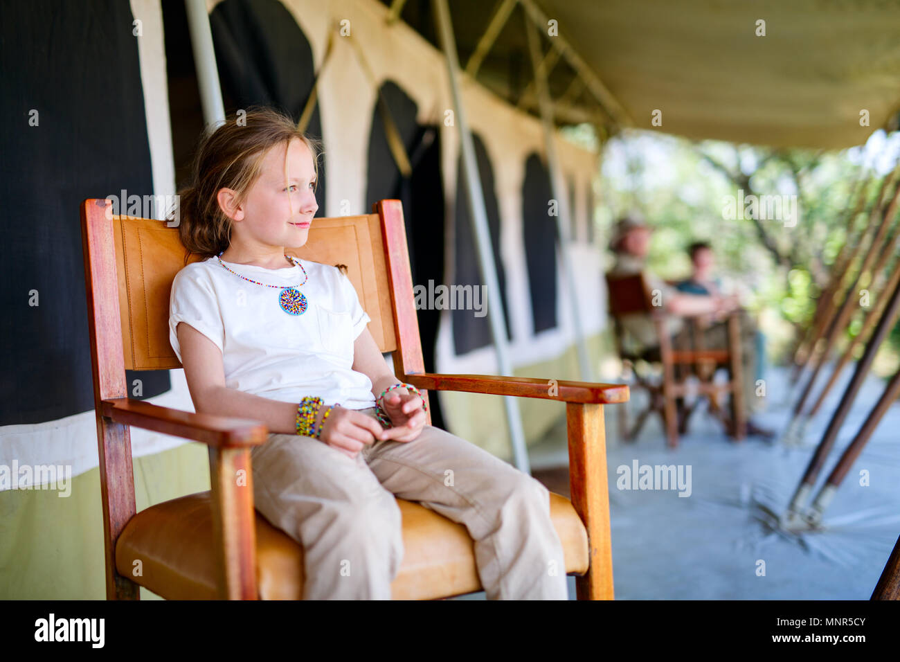 Family in safari tent enjoying vacation in Africa - Stock Image