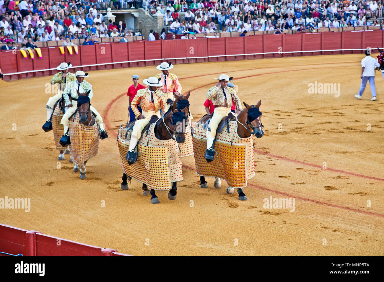 SEVILLE,SPAIN-SEP 11: Cuadrillas defile before a bullfight at Real Maestranza de Caballeria, Sep 11, 2011,Seville, Spain.Royal Cavalry of Seville is I - Stock Image