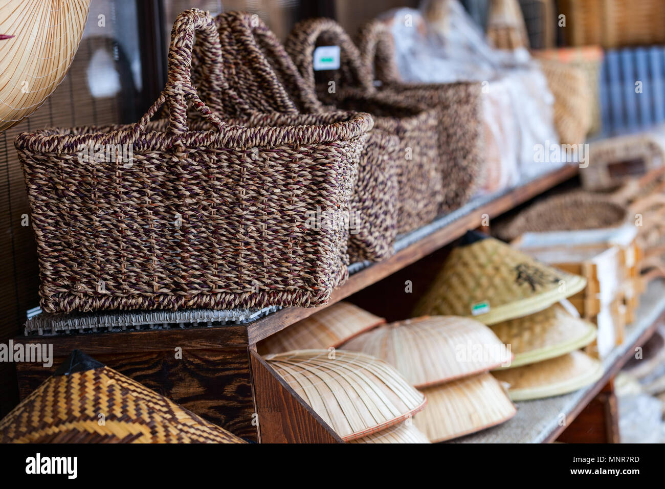 Japanese souvenirs straw hats and baskets - Stock Image