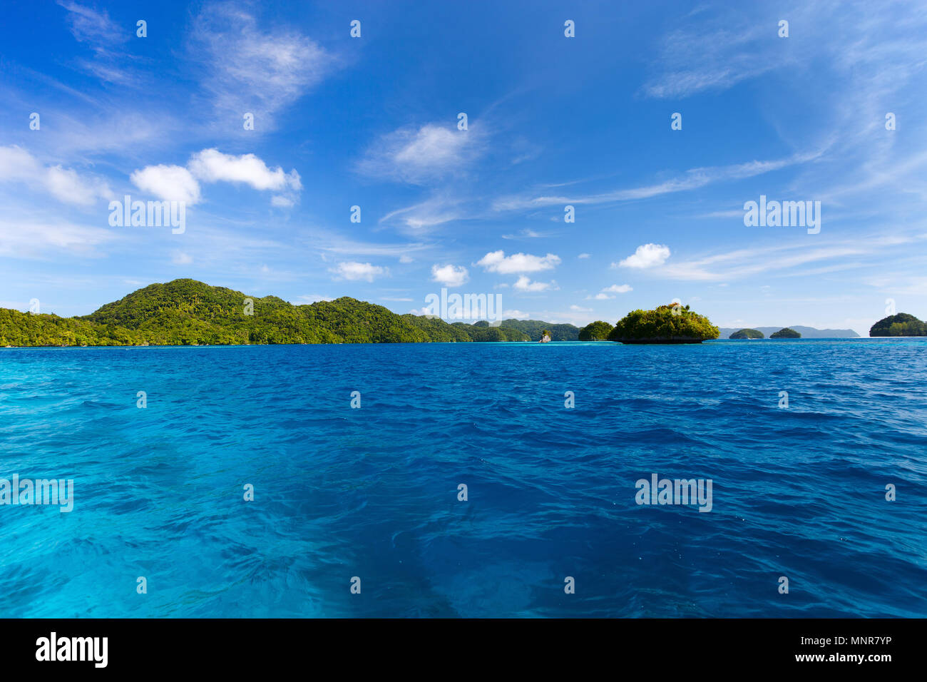 Scenic lagoon of Palau is characterized by hundreds of limestone islands Stock Photo