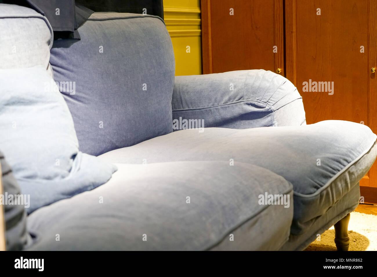 blue-jean sofa sitting on the home corner Stock Photo ...