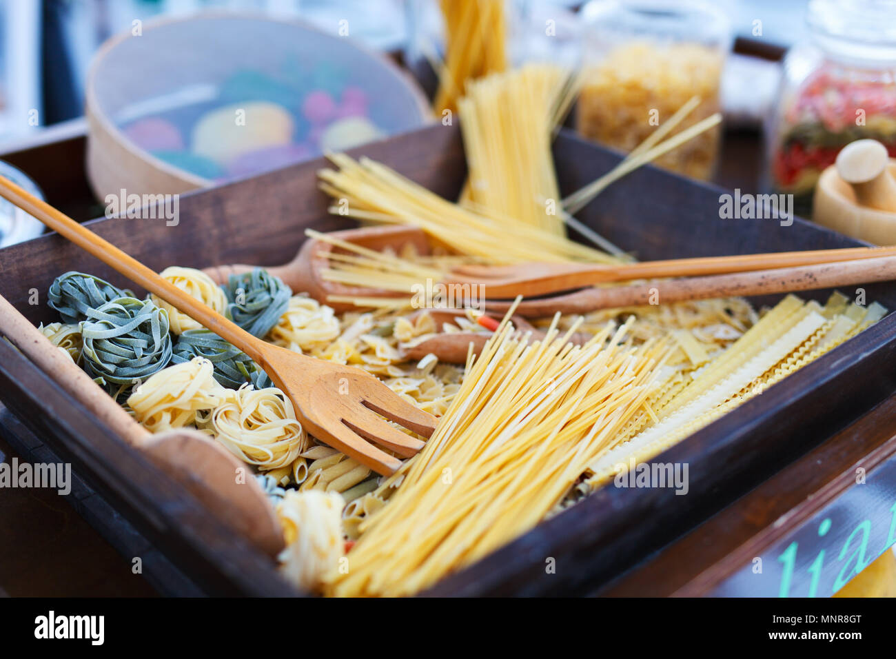 Variety of types and shapes of uncooked Italian pasta - Stock Image