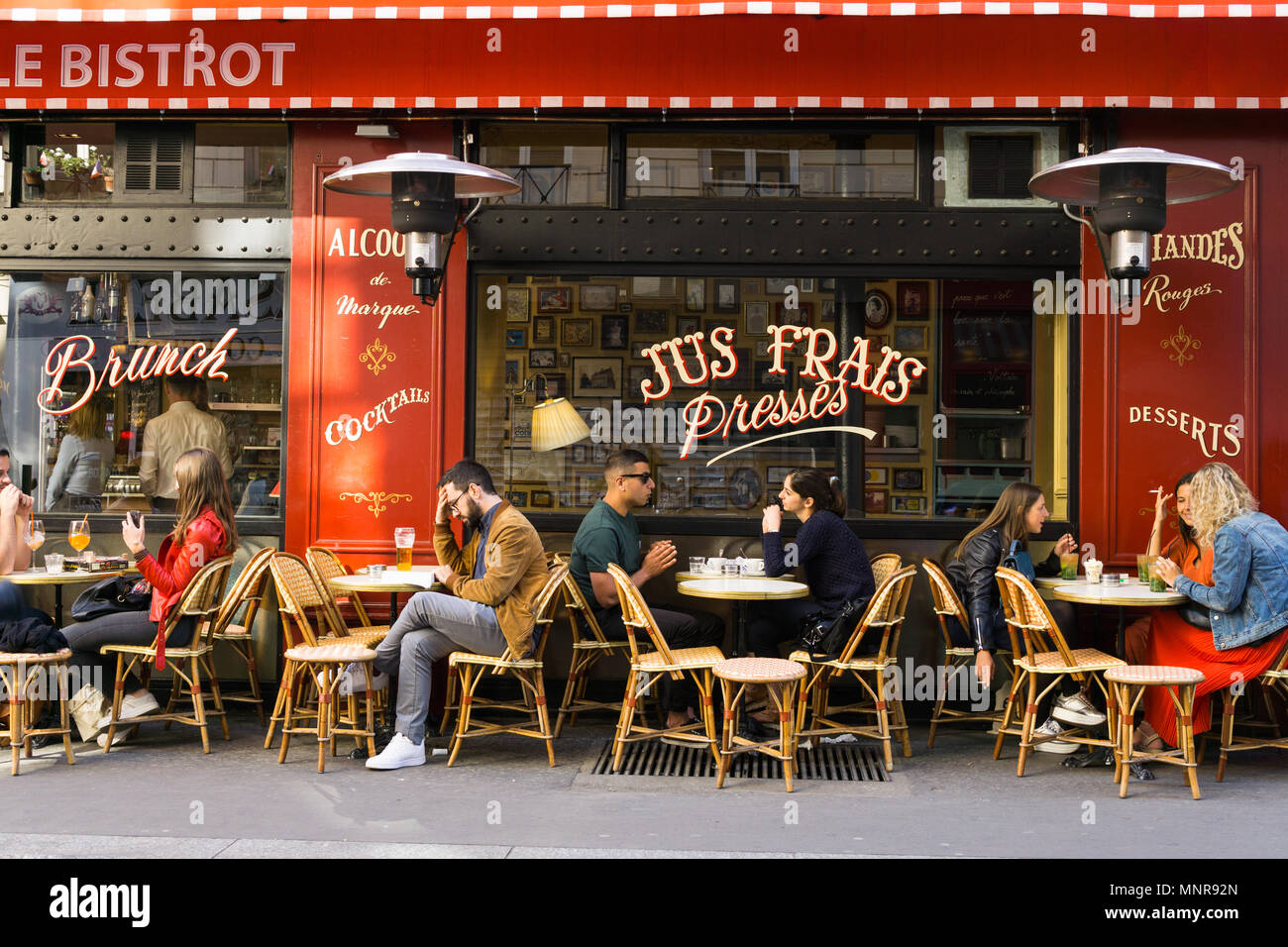 Patrons chatting in the cafe Le Bistrot on Boulevard de Magenta in Paris, France - Stock Image