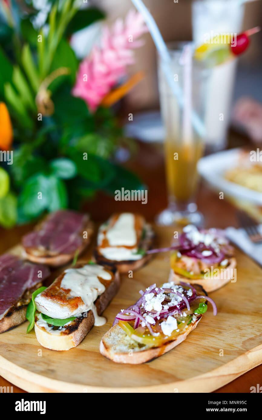 Different kinds of fresh homemade crispy Italian antipasto bruschettas - Stock Image
