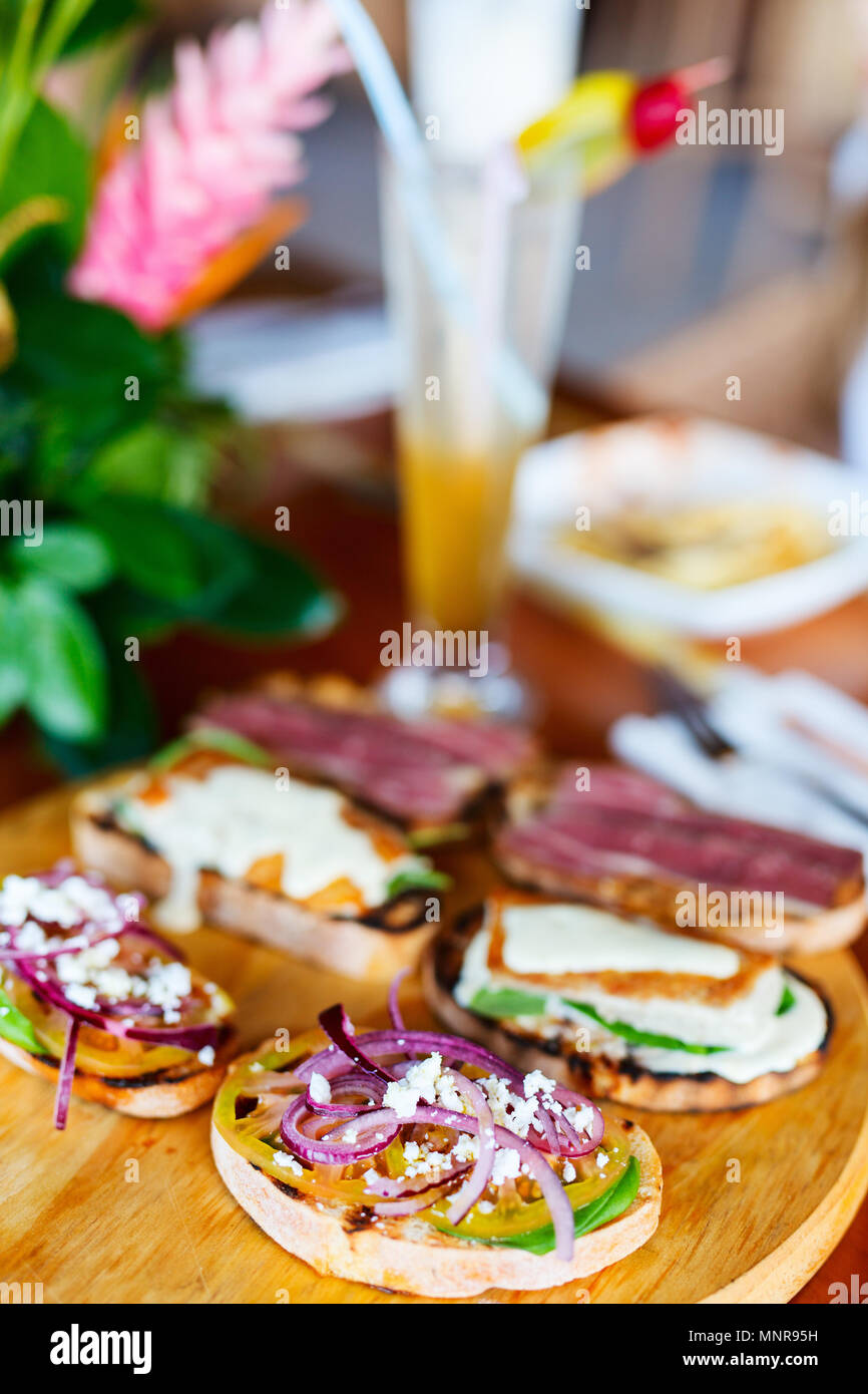 Different kinds of fresh homemade crispy Italian antipasto bruschettas Stock Photo