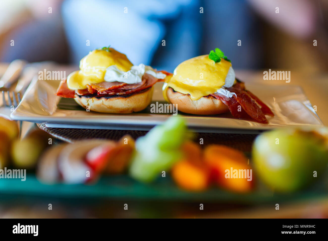 Delicious breakfast with poached eggs Benedict - Stock Image