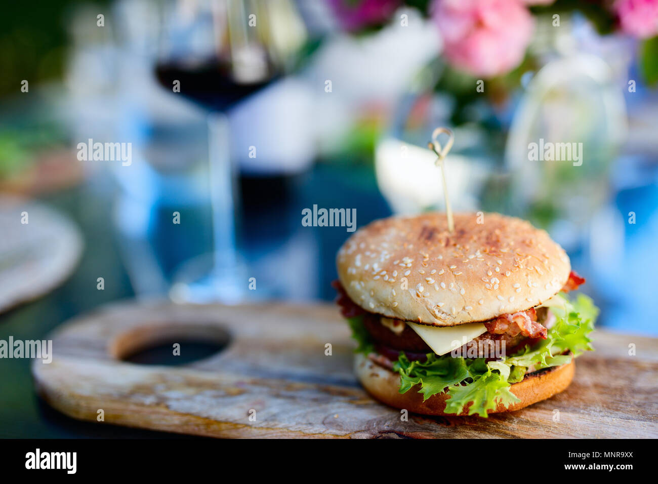 Close up of delicious fresh burger with cheese and bacon - Stock Image
