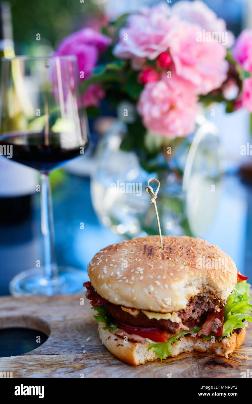 Close up of delicious fresh burger with cheese and bacon Stock Photo