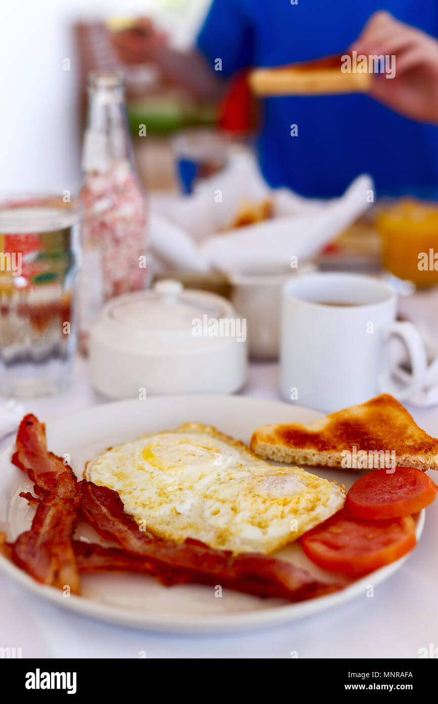 Delicious breakfast with omelet,  bacon and vegetables - Stock Image