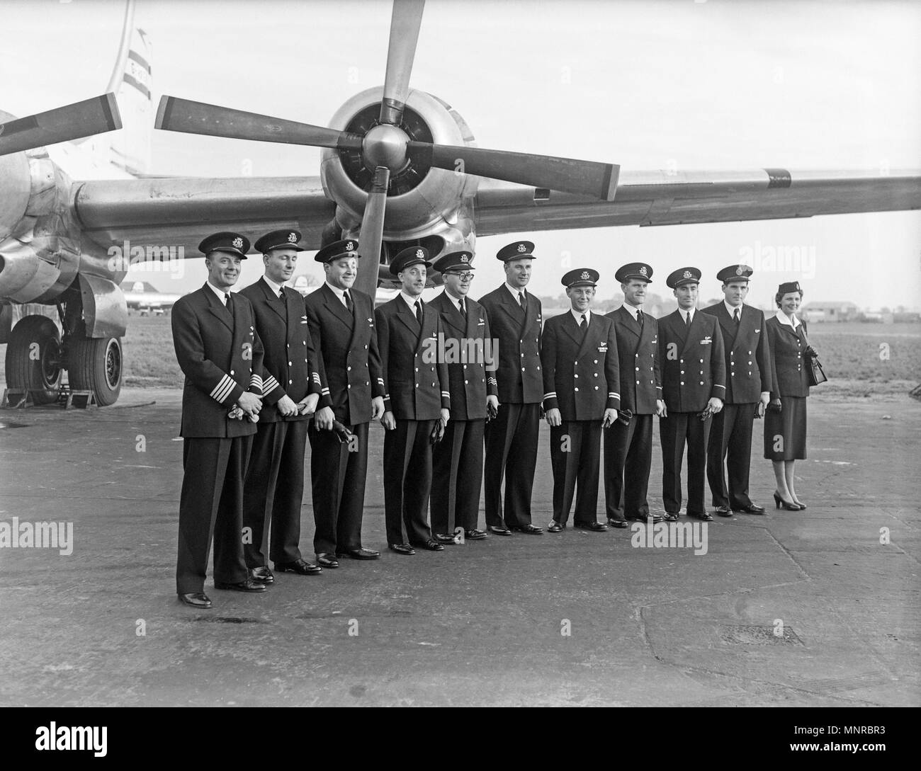 The BOAC crew who flew Queen Elizabeth to Jamaica in 1953, posing infant of the Boeing Stratocruiser which was used for the trip. - Stock Image