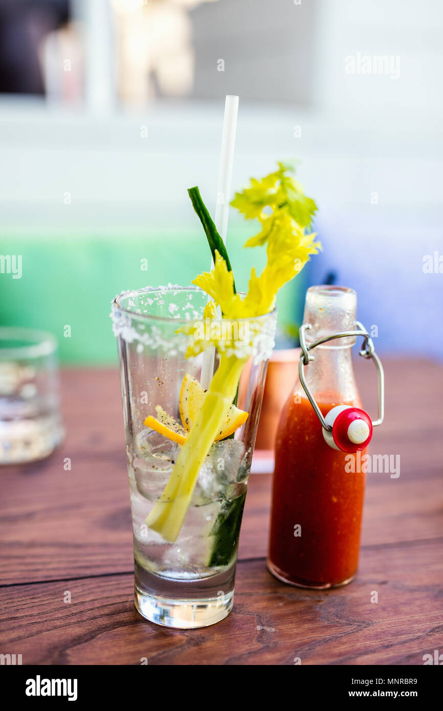 Close up of Bloody Mary cocktail served in a bar or restaurant - Stock Image