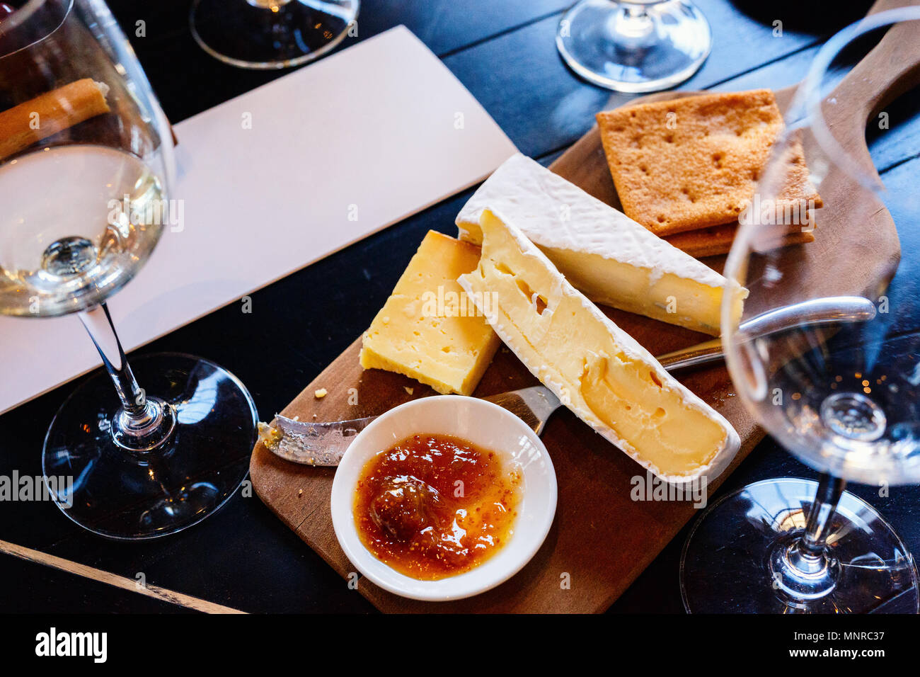 Wine and cheese tasting in South Africa estate in Western Cape wine-growing region - Stock Image