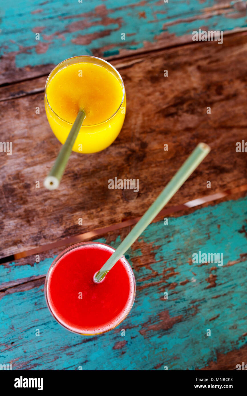 Tropical watermelon and mango juices on a table - Stock Image