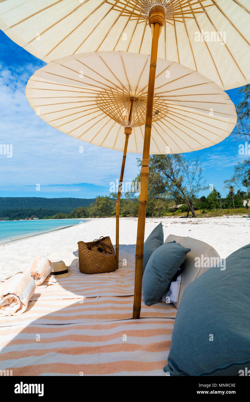 Luxury picnic on beautiful white sand exotic beach on Koh Rong island in Cambodia - Stock Image