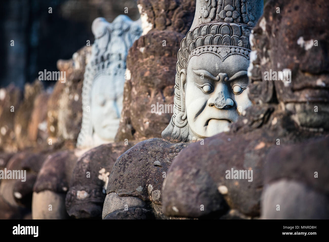 South Gate statues in Angkor Archeological area in Cambodia - Stock Image