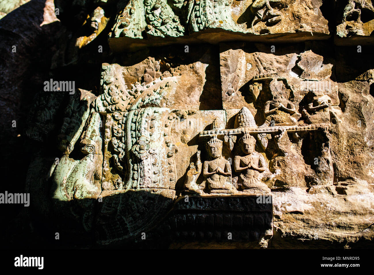 Close up bas reliefs in Angkor Archaeological area temple in Cambodia - Stock Image