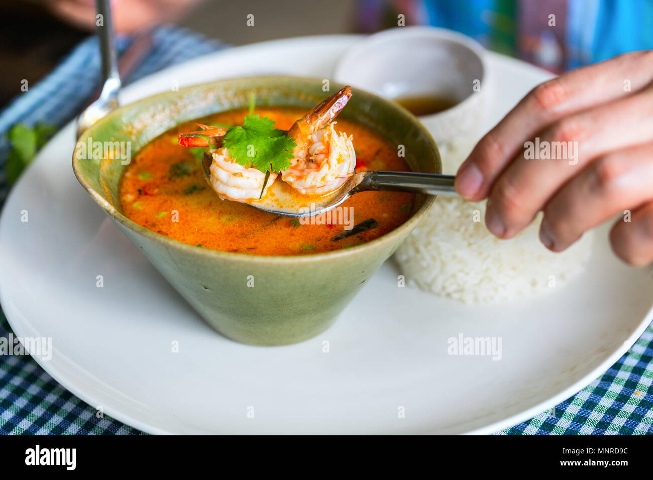 Delicious Asian Tom Yum soup served for lunch in restaurant - Stock Image