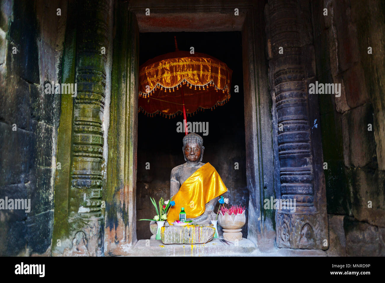 Buddha statue in Angkor Archeological area in Cambodia - Stock Image