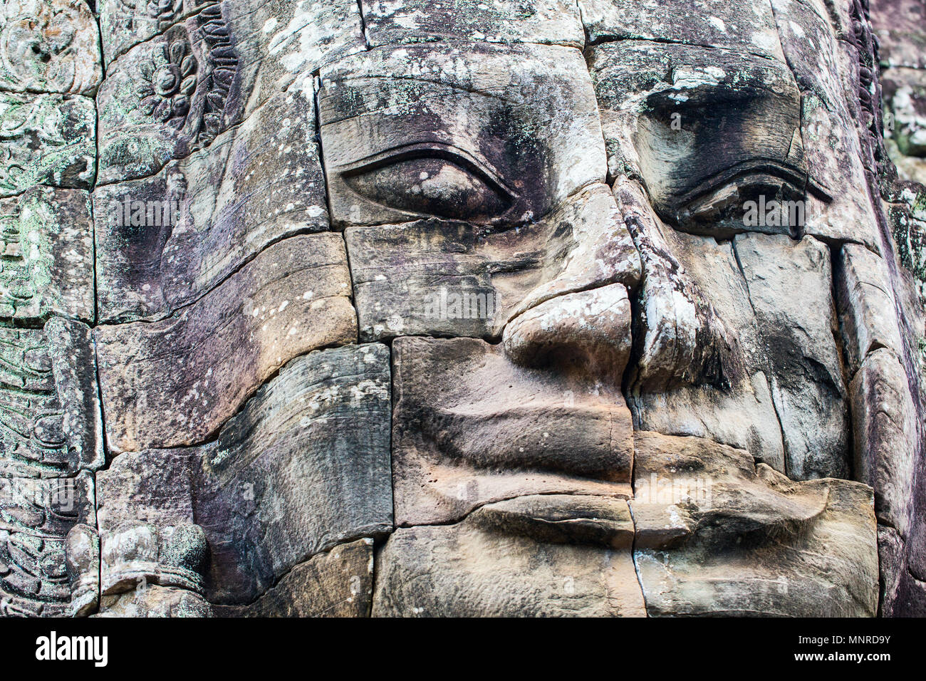 Faces of ancient Bayon temple popular tourist attraction in Angkor Thom,  Siem Reap,  Cambodia. - Stock Image