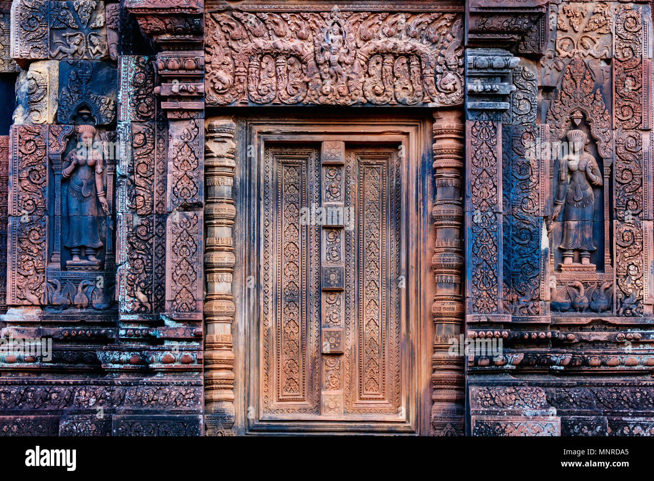 Beautiful Banteay Srei temple carvings in Angkor Archaeological area in Cambodia - Stock Image