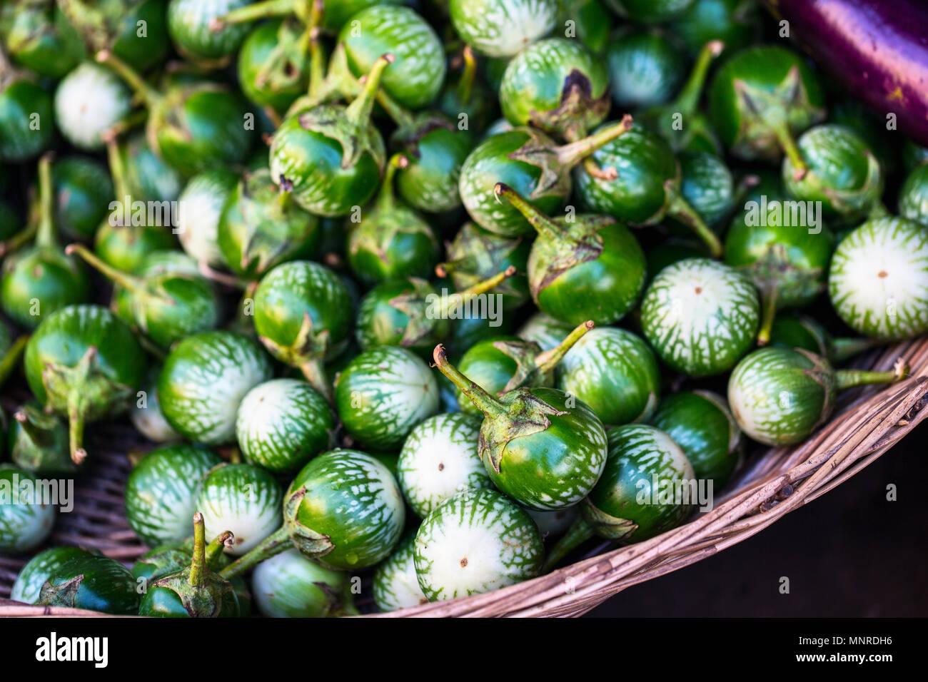 Assortment of fresh green fruits on market tray in Siem Reap Cambodia - Stock Image