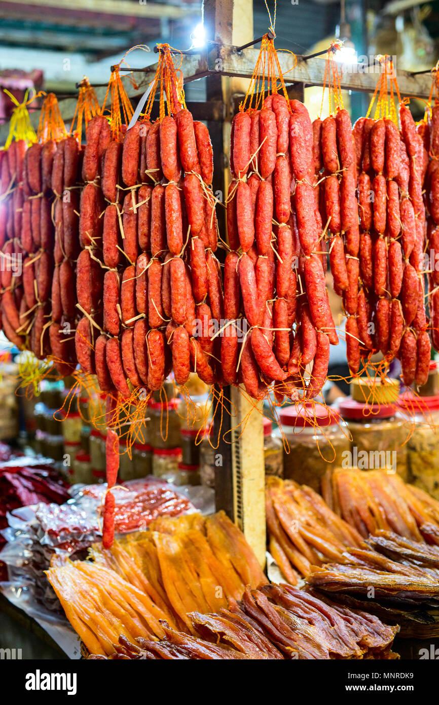 BBQ sausages at street market in Hong Kong - Stock Image