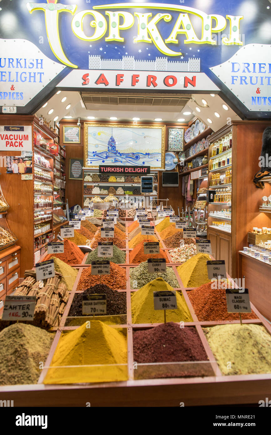 Exterior of storefront at Istanbul Spice bazaar in Turkey with copious bins full of colorful spices on display for sale Stock Photo
