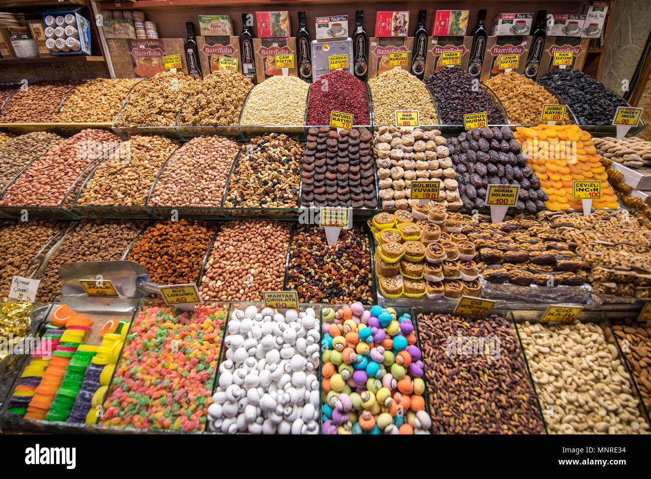 Neatly organized bins at Istanbul Spice bazaar in Turkey are brimming with sweets, nuts and dried fruits for customers to purchase - Stock Image