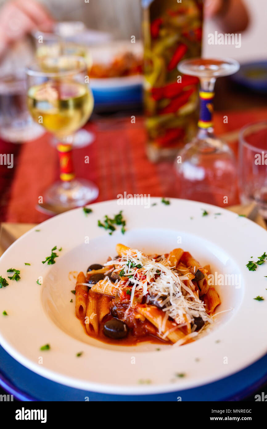 Delicious penne pasta served for lunch at luxury resort or restaurant - Stock Image