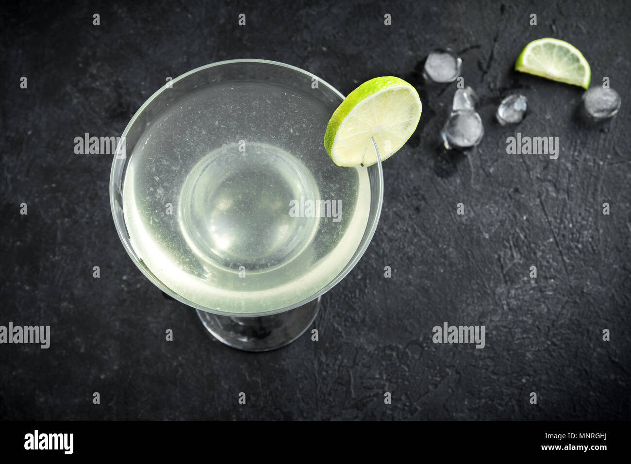 Gimlet Cocktail. Alcoholic Lime and Gin Gimlet on black background, copy space. Stock Photo