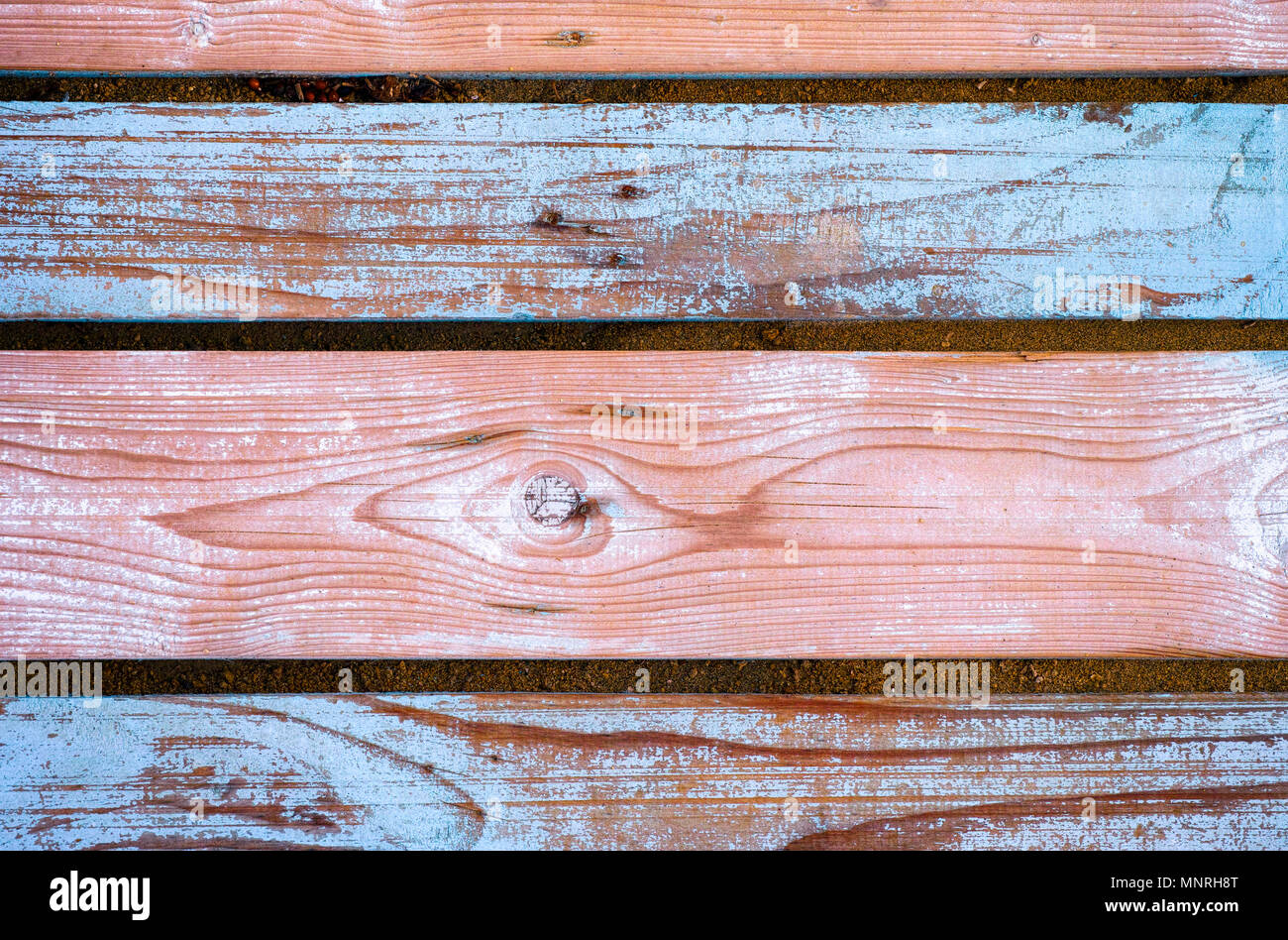 Background of wooden planks with peeling blue paint. Full frame. - Stock Image