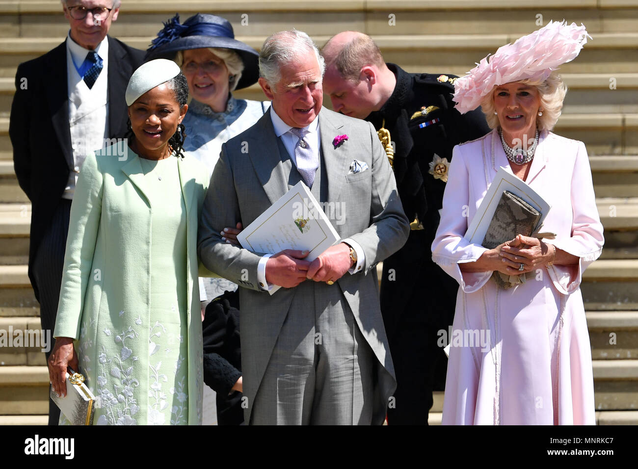Meghan Markle's mother Doria Ragland, the Prince of Wales and the Duchess of Cornwall, leave the wedding ceremony of Prince Harry, and Meghan Markle at St George's Chapel, Windsor Castle, in Windsor. Stock Photo