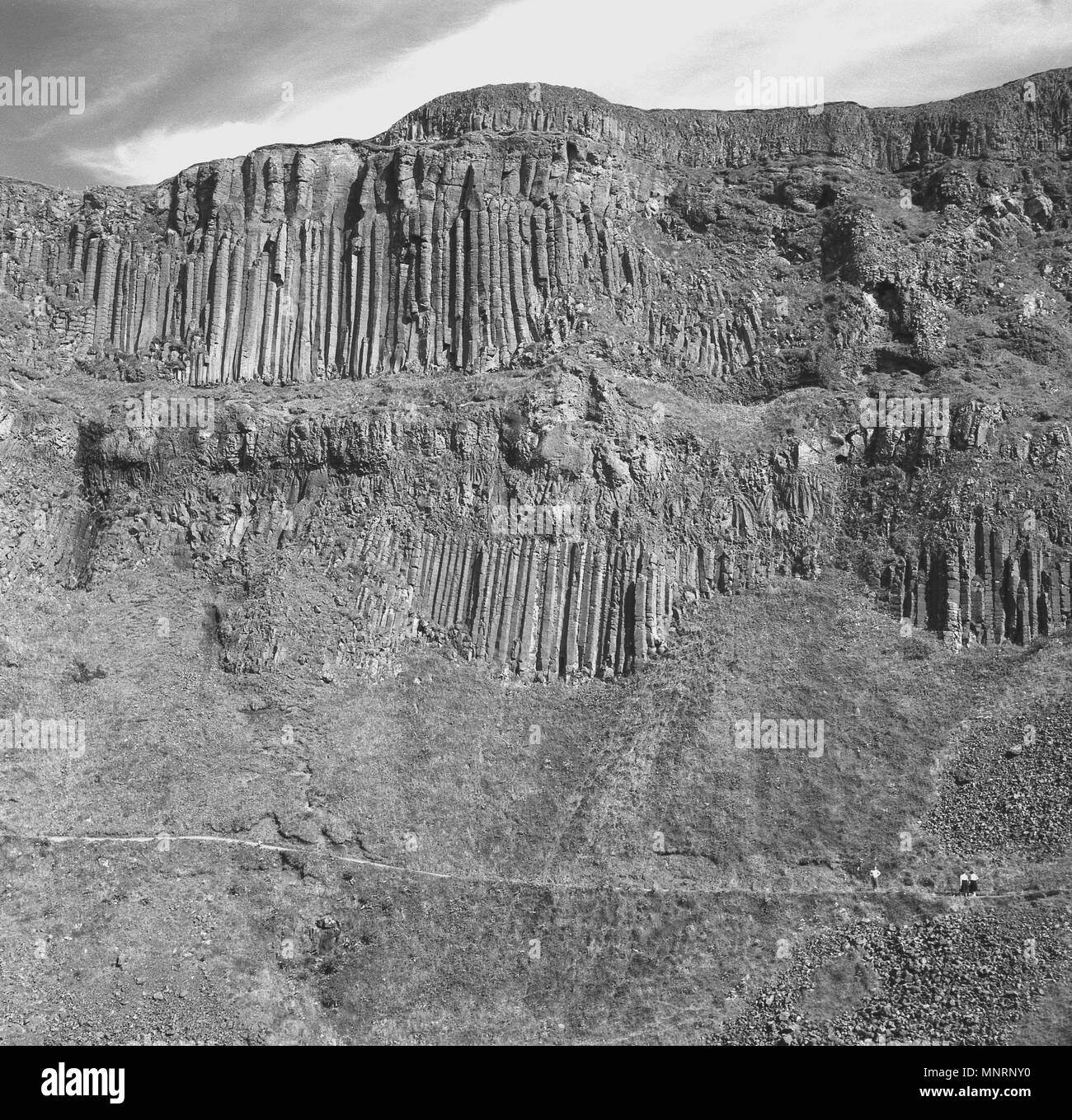 1950s, historical picture of the incredible ancient rock formations on the cliffs at the Giants Causeway, Co. Antrim, Northern Ireland. - Stock Image