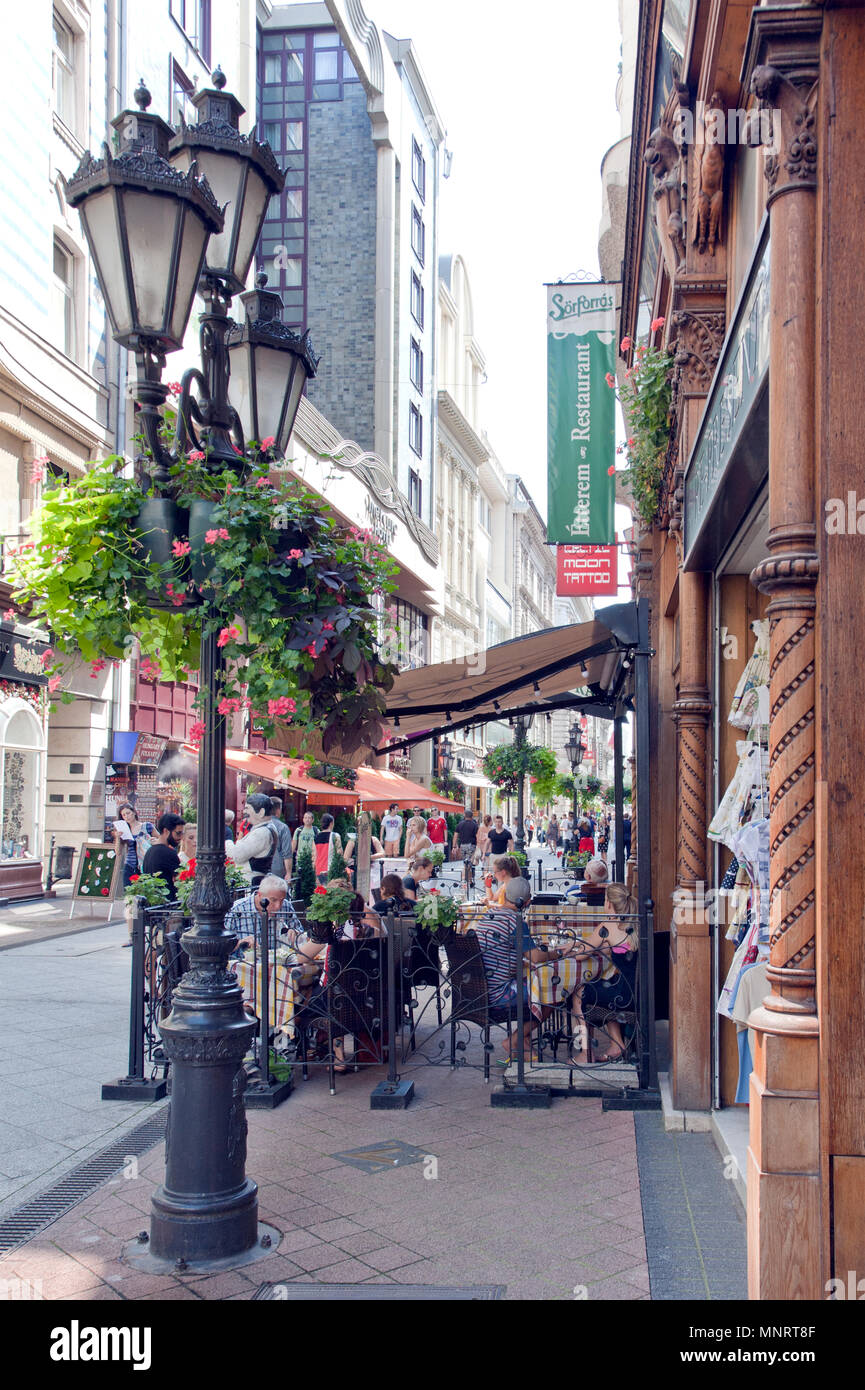 Sidewalk Cafe (Sorforra's Etterem) on Vaci Street, Budapest, Hungary. Váci utca (Váci street) is one of the main pedestrian thoroughfares. - Stock Image