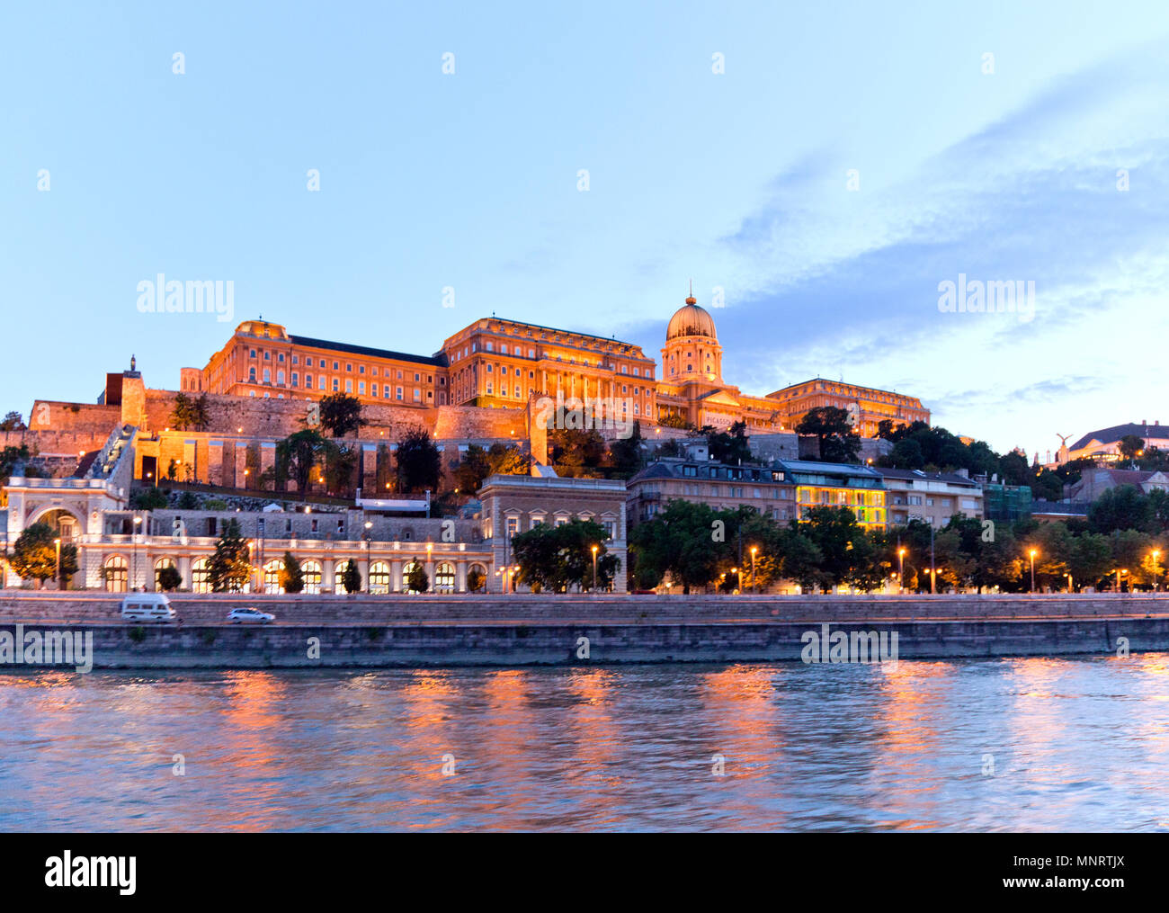 The Hungarian Royal Palace, now home to three museums, as seen at twilight from the Danube River, Budapest, Hungary. - Stock Image