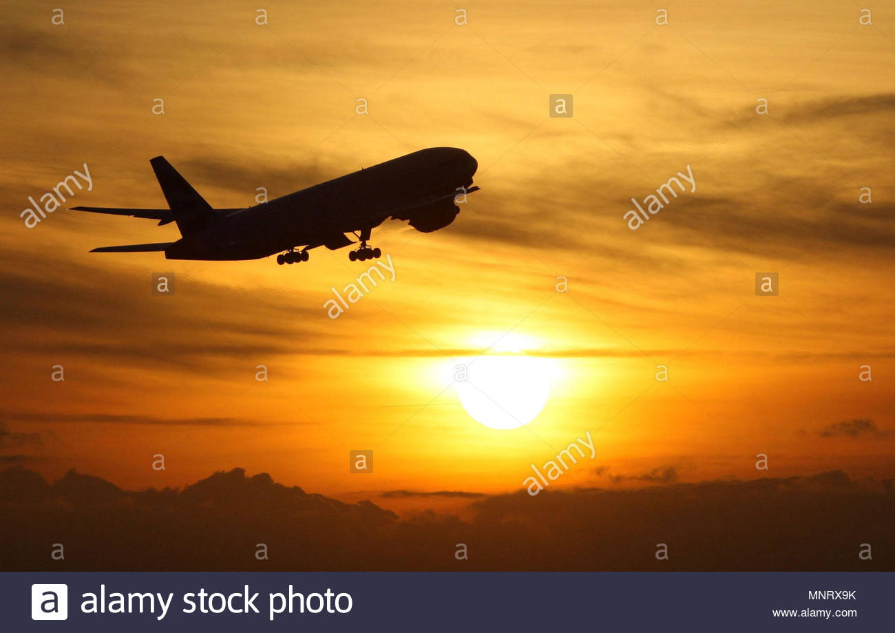 Embargoed to 0001 Monday May 21 File photo dated 19/11/08 of a plane taking off at sunset. The worst UK airports for flight punctuality have been revealed, with the longest delays at London Luton. - Stock Image
