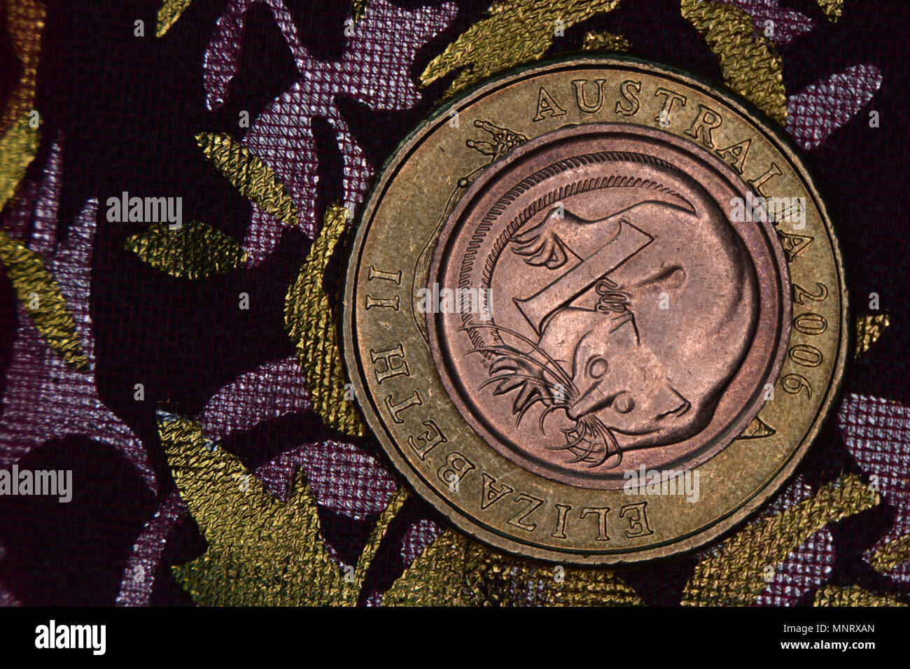 Finance pyramid - Australian coins stacked on each other. One cent coin discontinued in 1991 and withdrawn from circulation on the one dollar coin. - Stock Image