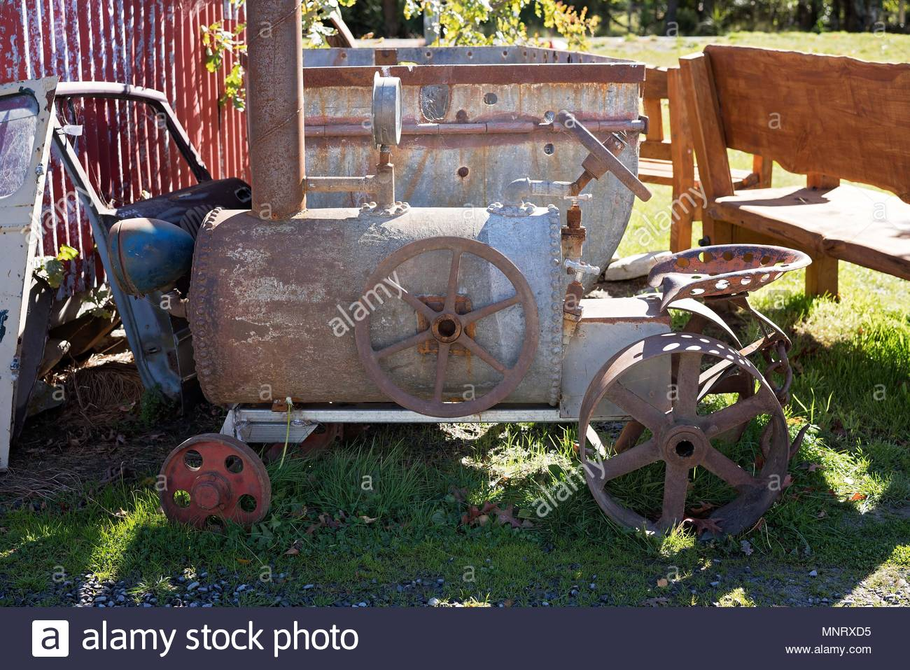 An Old Rusted Tractor From A Bygone Era Sitting Unused And Forgotten - Stock Image
