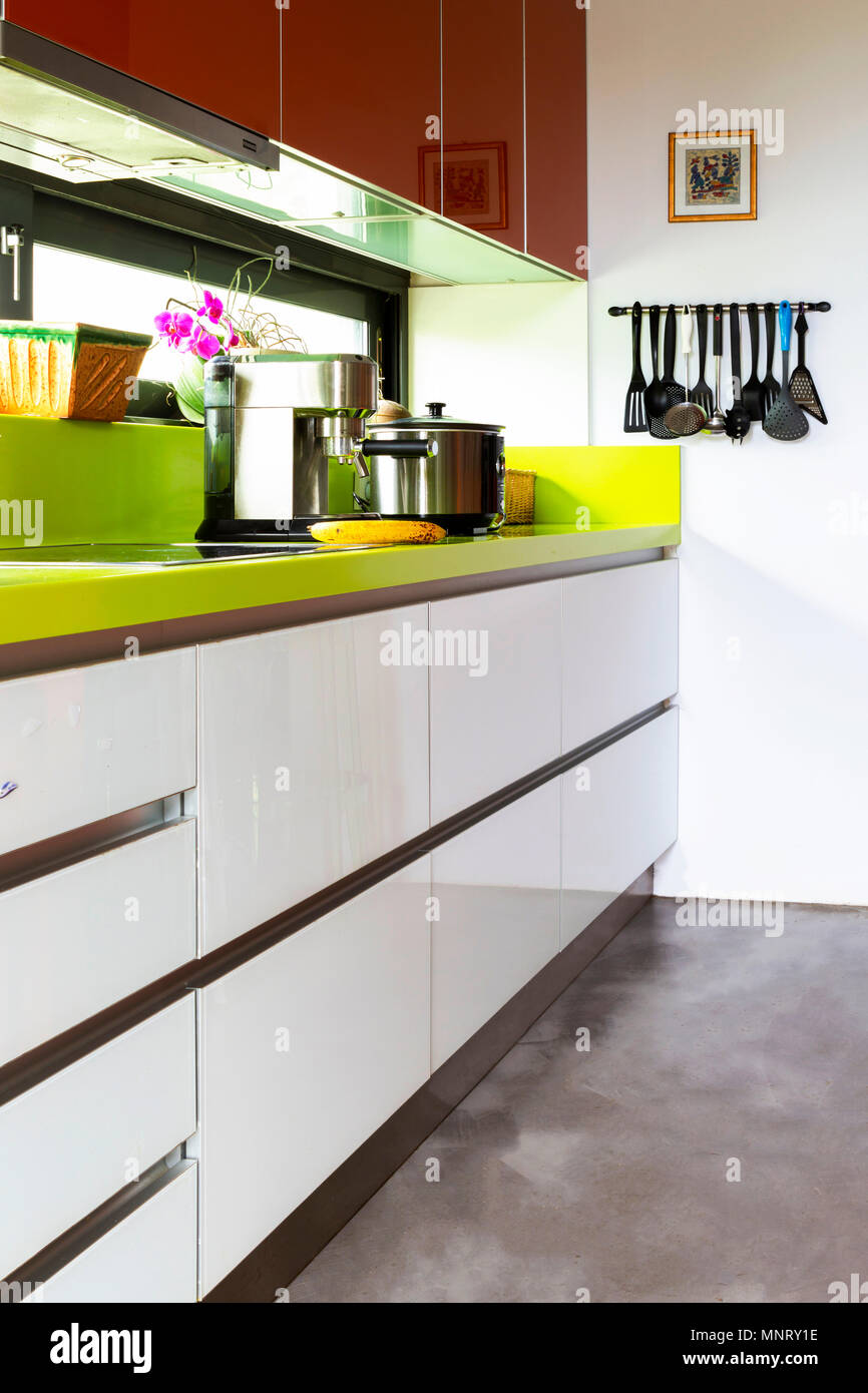 Minimal Designer Kitchen With Natural Window Light Utensils Kitchen Appliances Visible Vertical Orientation White Green Orange Colors Stock Photo Alamy