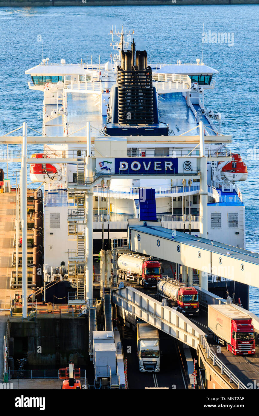 England, Dover harbour. DFDS 'Cote des Flandres' car ferry at terminal unloading trucks in the golden hour early morning. Stock Photo