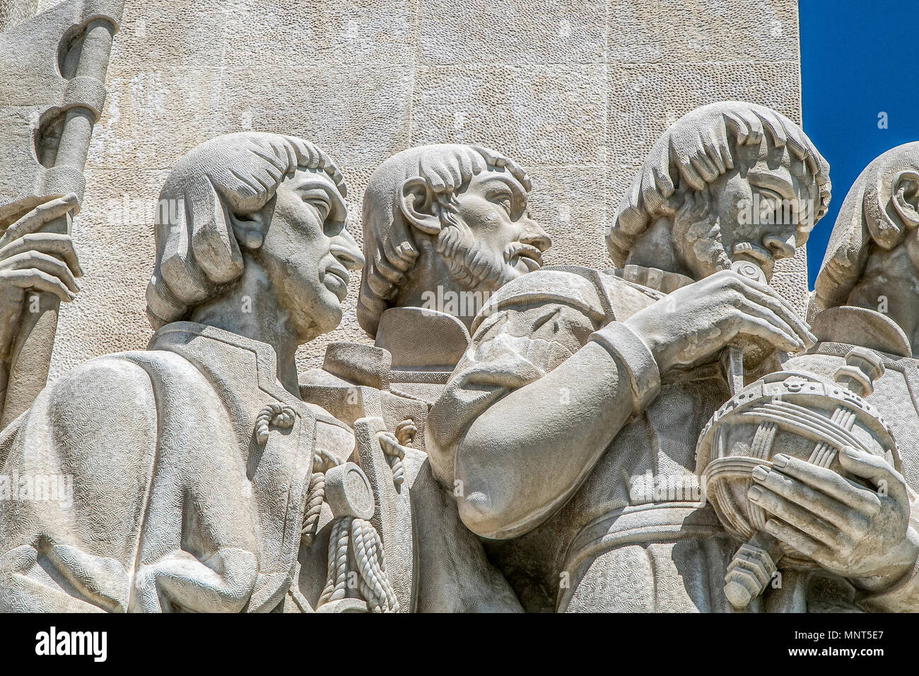 Lisbon, Portugal, May 5, 2018: Statues of Jacome of Majorca, Pero Escobar and Pedro Nunes, detail of the Monument to the Discoveries. - Stock Image