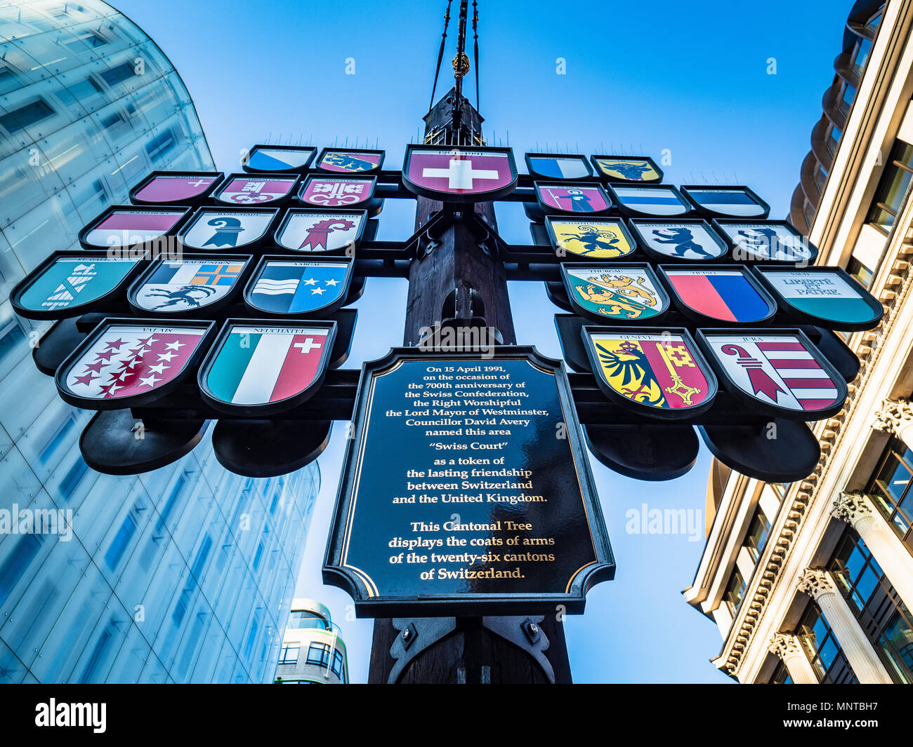 Swiss Canton Tree in London's West End - The Swiss Cantonal Tree in Swiss Court near Leicester Square, erected 1991 as a sign of UK Swiss friendship - Stock Image