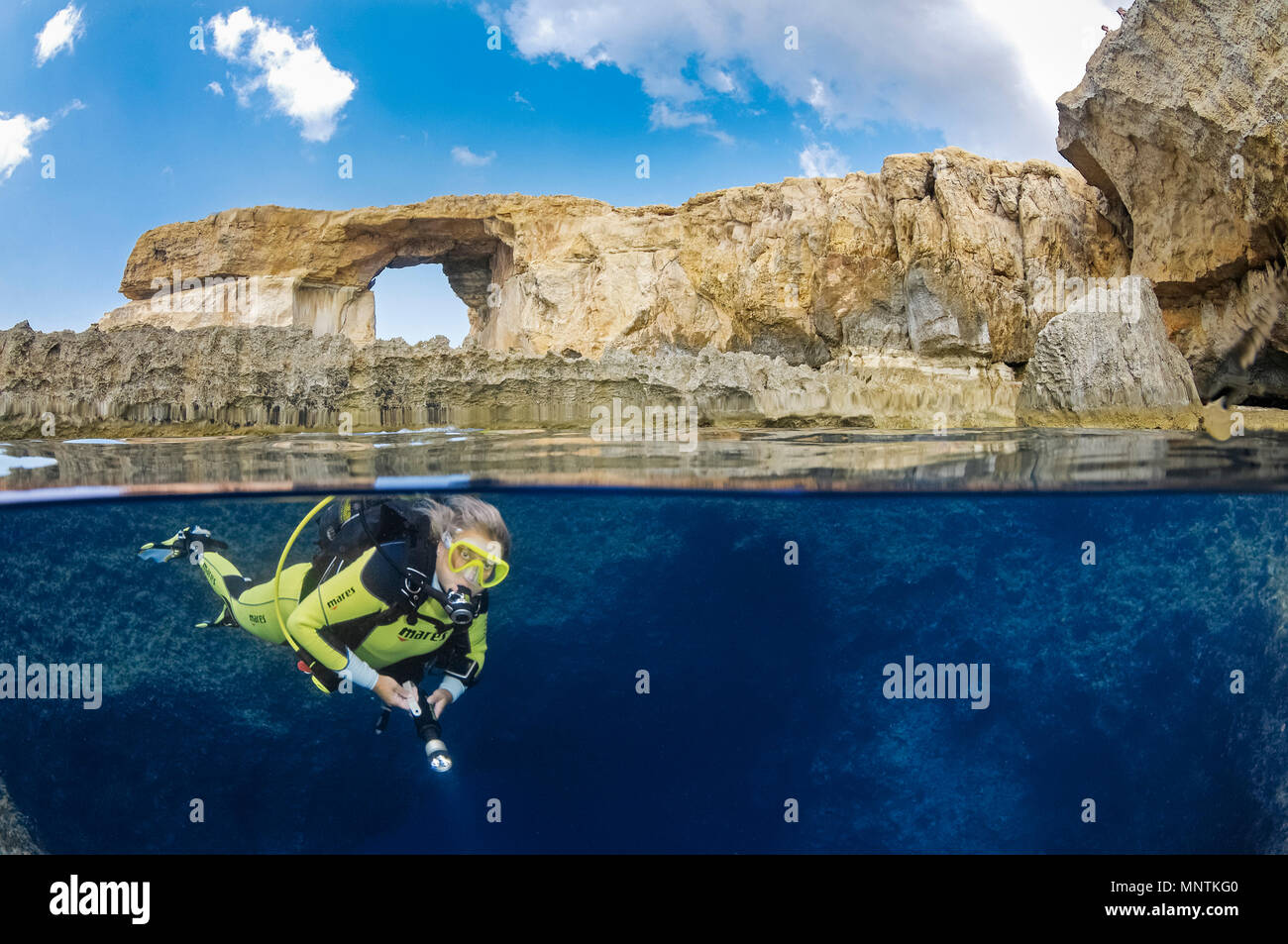 Azure Window, or Dwejra Window, and woman scuba diver in Blue Hole, Gozo, Malta, Mediterranean Sea, Atlantic Ocean, MR - Stock Image