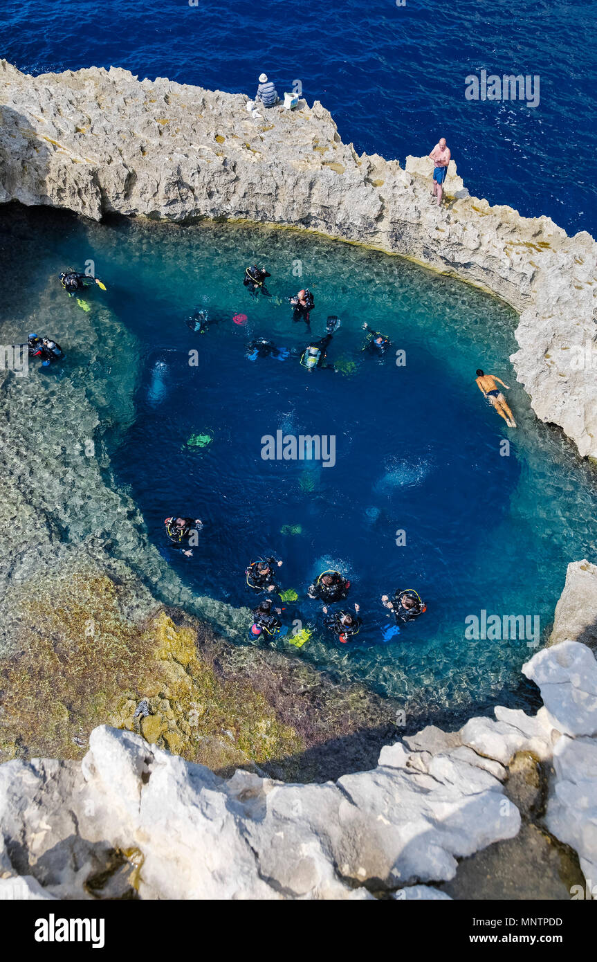 scuba divers and swimmers at Blue Hole, Gozo, Malta, Mediterranean Sea, Atlantic Ocean - Stock Image