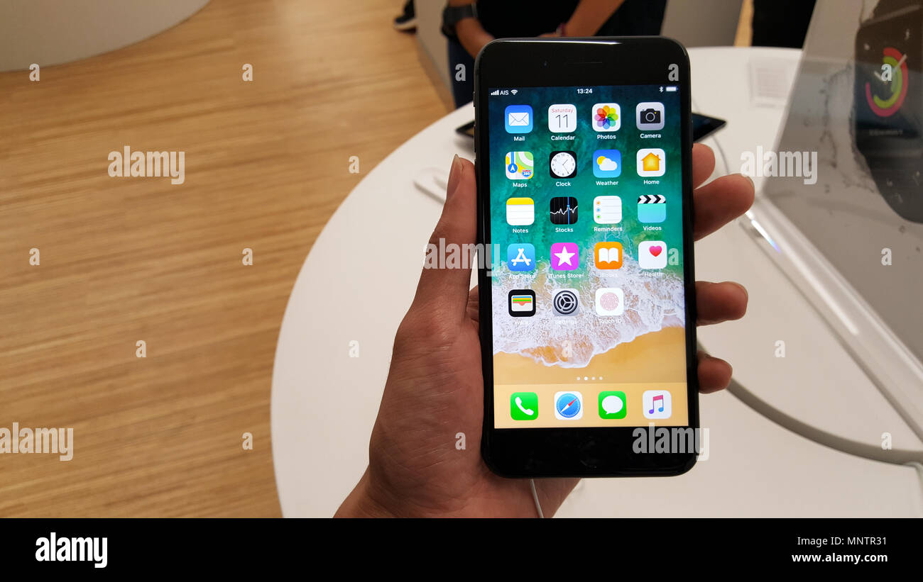 BANGKOK, THAILAND - NOVEMBER 11, 2017: iPhone 8 Plus is showing at iStudio Shop CentralWorld Shopping Mall for a customer to test the new iPhone using Stock Photo