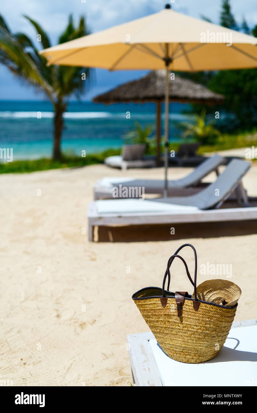 Close up of a straw bag on a tropical beach Stock Photo
