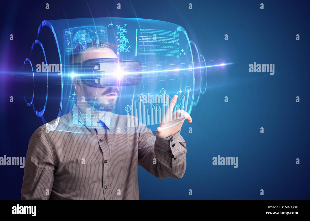 Amazed businessman with high tech 3D projection in front of