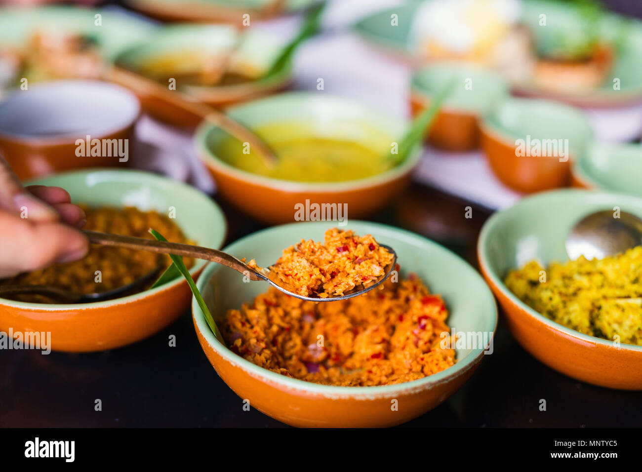 Coconut sambal close up on table with Sri Lankan food - Stock Image