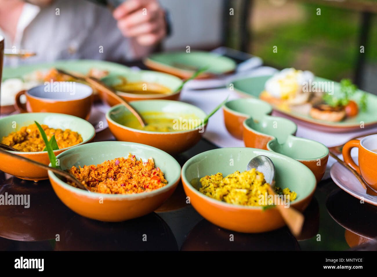 Coconut sambal and curry close up on table with Sri Lankan food - Stock Image